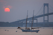 USA, Newport, RI - Lone schooner moored in Narragansett bay near the Newport Bridge