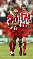 Fotball<br /> Foto: Fotosports/Digitalsport<br /> NORWAY ONLY<br /> <br /> Date: 29/08/2004<br /> <br /> Sheffield United v Leeds United<br /> Coca Cola Championship<br /> <br /> Sheffield's John Harley celebrates his goal with Michael Tonge