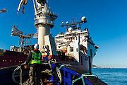 Tugboat approaching the Boa Sub C Multi purpose Offshore Vessel