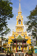"12 APRIL 2012 - HO CHI MINH CITY, VIETNAM:  Cha Tam Catholic Church in Cholon. The church is best known as the last hiding placing of Vietnamese Catholic dictator and US ally, President Ngo Dinh Diem, before he was assassinated in November 1963. Cholon is the Chinese-influenced section of Ho Chi Minh City (former Saigon). It is the largest ""Chinatown"" in Vietnam. Cholon consists of the western half of District 5 as well as several adjoining neighborhoods in District 6. The Vietnamese name Cholon literally means ""big"" (lon) ""market"" (cho). Incorporated in 1879 as a city 11 km from central Saigon. By the 1930s, it had expanded to the city limit of Saigon. On April 27, 1931, French colonial authorities merged the two cities to form Saigon-Cholon. In 1956, ""Cholon"" was dropped from the name and the city became known as Saigon. During the Vietnam War (called the American War by the Vietnamese), soldiers and deserters from the United States Army maintained a thriving black market in Cholon, trading in various American and especially U.S Army-issue items.         PHOTO BY JACK KURTZ"