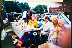Toni, second from right with her neighbours at a car boot sale in the 1990s. Eighty-year-old great grandmother Toni Goldenberg save up her pennies to pay for a facelift in February 2019, giving her extra confidence and a look to match her youthful approach to life. Wallington, Surrey, March 28 2019.