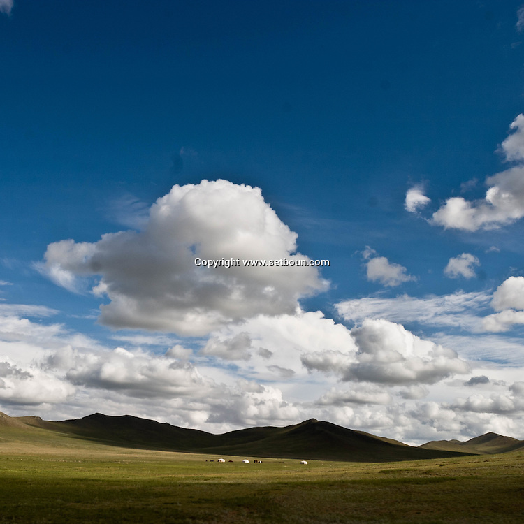 Mongolia. steppe landscape, clouds , blue sky, , on the road karakorum road,    -