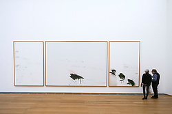 Visitors looking at installation Thyrsis by Cy Twombly at Hamburger Bahnhof modern art museum in Berlin, Germany