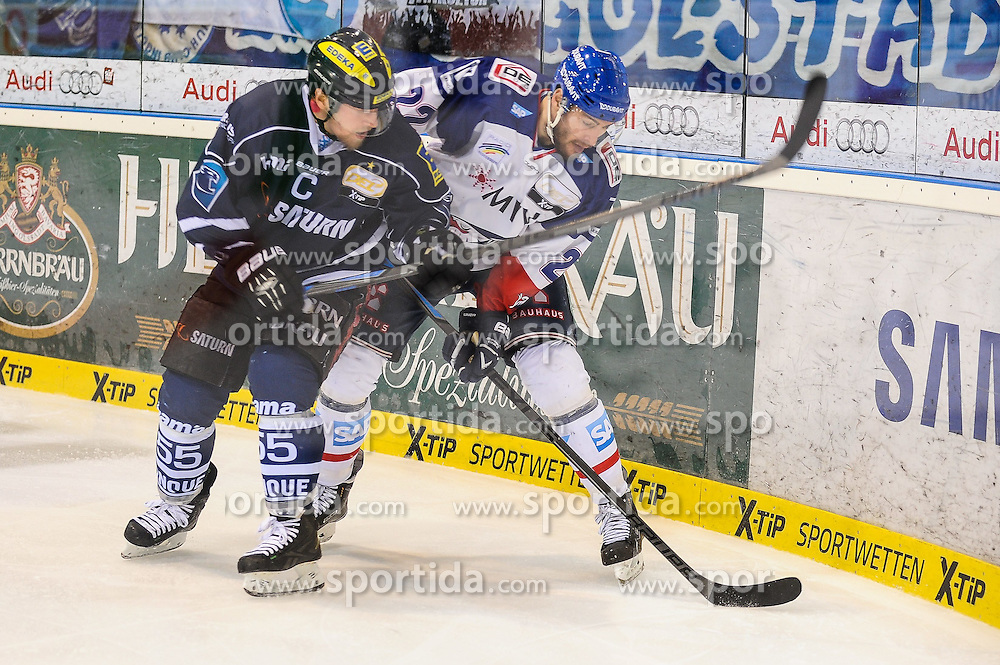 12.04.2015, Saturn Arena, Ingolstadt, GER, DEL, ERC Ingolstadt vs Adler Mannheim, Playoff, Finale, 2. Spiel, im Bild im Zweikampf, Aktion, mit von links Patrick Koeppchen (ERC Ingolstadt) 55 links mir Matthias Plachta (Adler Mannheim) 22 // during Germans DEL Icehockey League 2nd final match between ERC Ingolstadt and Adler Mannheim at the Saturn Arena in Ingolstadt, Germany on 2015/04/12. EXPA Pictures &copy; 2015, PhotoCredit: EXPA/ Eibner-Pressefoto/ Schreyer<br /> <br /> *****ATTENTION - OUT of GER*****