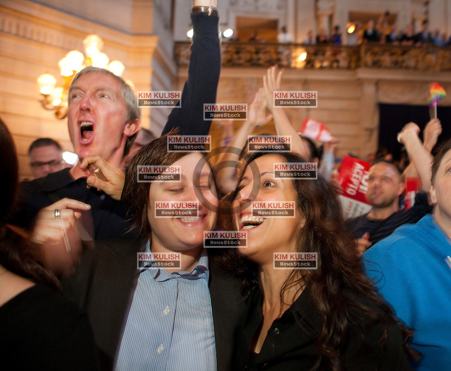 Same-sex couple Lori Bilella and Renara Moreira celebrate  the decisions  from the U.S. Supreme Court on gay marriage inside the San Francisco City Hall.  The court struck down the Defense of Marriage Act  and ruled that Proposition 8 supporters of California's ban on gay marriage, could not defend it before the Supreme Court.