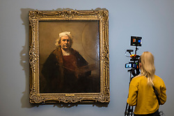 "© Licensed to London News Pictures. 11/04/2019. LONDON, UK. A camerawoman views ""Self-Portrait with Two Circles"", 1665, by Rembrandt van Rijn, the highlight of the exhibition. Preview of ""Visions of the Self:  Rembrandt and Now"", an exhibition at Gagosian Grosvenor Hill, in partnership with English Heritage.  The show features self-portraits by Pablo Picasso, Frances Bacon, Lucian Freud and Jean-Michel Basquiat alongside contemporary artists including George Baselitz, and Damian Hirst.  Photo credit: Stephen Chung/LNP"