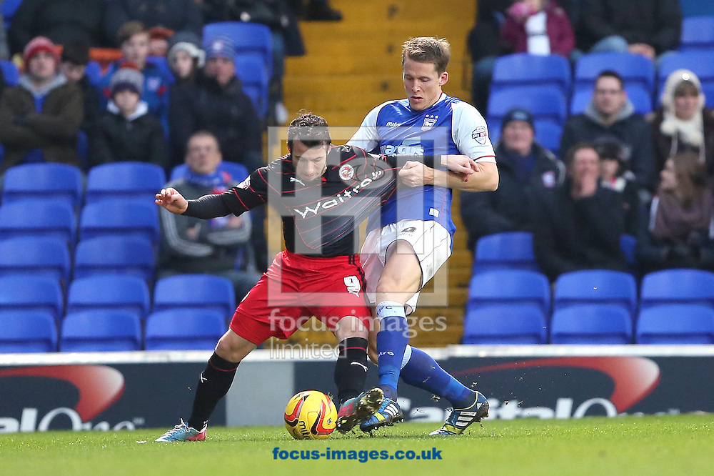 Picture by Richard Calver/Focus Images Ltd +447792 981244<br /> 25/01/2014<br /> Christophe Berra of Ipswich Town and Adam Le Fondre of Reading fight for the ball during the Sky Bet Championship match at Portman Road, Ipswich.
