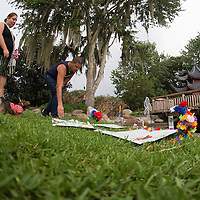 Mourners place flowers at a makeshift memorial at Lake Eola Park for the victims of the Pulse nightclub where many victims were killed in the deadliest shooting in modern U.S. History on Tuesday, June 14, 2016, in Orlando, Fla. (Alex Menendez via AP)