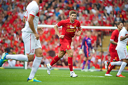 03.08.2013, Anfield Stadion, Liverpool, ENG, Testspiel, Liverpool FC vs Olympiakos CFP, im Bild Liverpool's captain Steven Gerrard in action against Olympiakos CFP during a preseason friendly match at Anfield during the friendly Match between Liverpool FC and Olympiakos CFP at the Anfield Stadion, Liverpool, England on 2013/08/03. EXPA Pictures © 2013, PhotoCredit: EXPA/ Propagandaphoto/ David Rawcliffe<br /> <br /> ***** ATTENTION - OUT OF ENG, GBR, UK *****