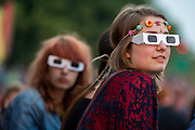 People try out their 3d glasses before the start of Kraftwerk's performance on the Obelisk Stage. The 2013 Latitude Festival, Henham Park, Southwold, Suffolk, UK. © Guy Bell photography, GBphotos