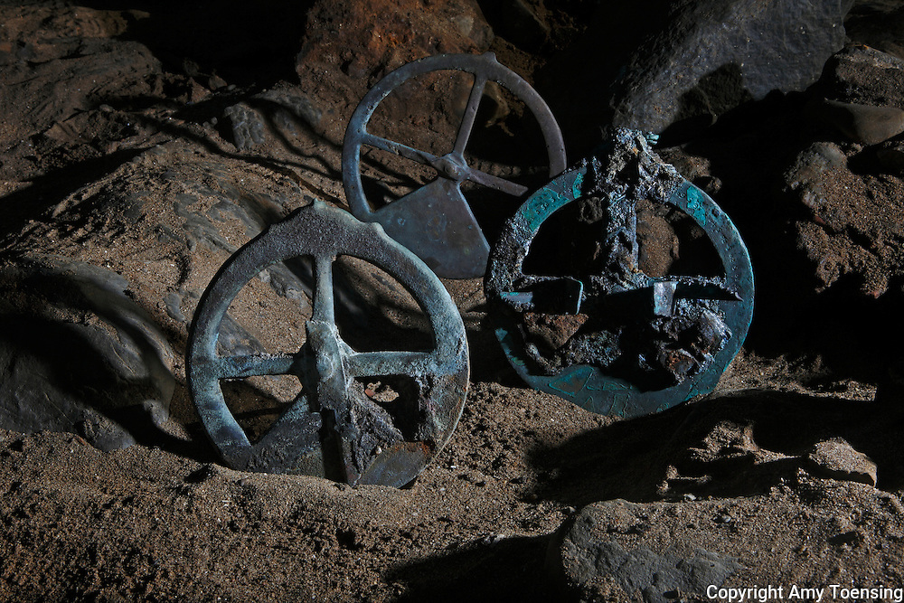 ORANJEMUND, NAMIBIA -- OCTOBER 04: Three astrolabes found on site of the discovered Portuguese shipwreck on October 01, 2008 in Oranjemund, Namibia. This was the navigational tool used to make astronomical measurements of the altitude of celestial bodies for calculating latitude, before the development of the sextant. The wreck was discovered seven meters below sea level on April 1, 2008 by miners in the Namdeb diamond mine in Oranjemund, Namibia. Archeologists established that the wreck is from the early 1500s. Items found at the site include: copper ingots, bronze canons, canon balls, pewter bowls and plates and ivory tusks from African elephants. The most substantial find was over 2000 gold coins -approximately 21 kg- the most gold found in Africa since the Valley of the Kings in Egypt. (Photo by Amy Toensing) _________________________________<br /> <br /> For stock or print inquires, please email us at studio@moyer-toensing.com.