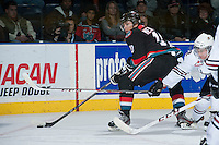 KELOWNA, CANADA - NOVEMBER 6: Nick Merkley #10 of the Kelowna Rockets moves the puck toward the net of the Red Deer Rebels on NOVEMBER 6, 2013 at Prospera Place in Kelowna, British Columbia, Canada.   (Photo by Marissa Baecker/Shoot the Breeze)  ***  Local Caption  ***