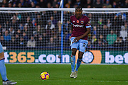 Issa Diop of West Ham United (23) passes the ball forward during the Premier League match between Huddersfield Town and West Ham United at the John Smiths Stadium, Huddersfield, England on 10 November 2018.