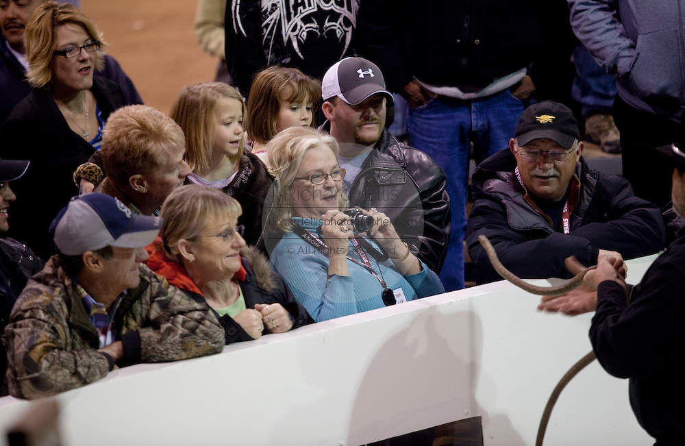 SWEETWATER, TX - MARCH 14: Spectators react to a western diamondback rattlesnake brought in by hunters during the 51st Annual Sweetwater Texas Rattlesnake Round-Up, March 14, 2009 in Sweetwater, Texas. Approximately 24,000 pounds of rattlesnakes will be collected, milked for venom and the meat served to support charity. (Photo by Richard Ellis)