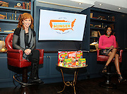 Music icon Reba, left, and NBC and E! News correspondent Alicia Quarles discuss the Outnumber Hunger campaign, a partnership between General Mills, Big Machine Label Group and Feeding America, Monday, April 13, 2015, in New York.  Reba is the face of the 2015 Outnumber Hunger campaign that helps raise awareness of the 49 million Americans struggling with hunger in the United States.  (Photo by Diane Bondareff/Invision for General Mills/AP Images)