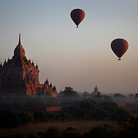 Visitors to ancient Bagan can view the sunrise from the sky in one of seven hotair balloons or from the top of some temples.