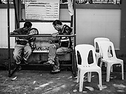 "04 ARIL 2017 - BANGKOK, THAILAND: Motorcycle taxi drivers (called ""motosai"" locally) play chess while they wait for fares in the Thonburi section of Bangkok.       PHOTO BY JACK KURTZ"