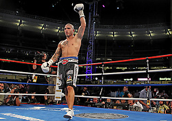 June 5, 2010; Bronx, NY; USA;  Miguel Cotto celebrates his 9th round TKO win over Yuri Foreman at Yankee Stadium in the Bronx, NY.  The fight was the first in Yankee Stadium since 1976.