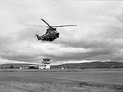 "Air Corps Takes Delivery Of Puma Helicoptor. (N86)..1981..22.07.1981..07.22.1981..22nd July 1981..The Air Corps took delivery,today, of a new French Built SA 330 J ""Puma"" Helicoptor. The ""Puma"" escorted by another Air Corps helicoptor landed at Casement Aerodrome, Baldonnell,Co Dublin...Picture shows the ""Puma"" doing a fly past over the runways at the aerodrome."