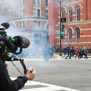 Washington DC, USA, 20 January, 2017.DisruptJ20 protests police throw flash grenades, Presidential inauguration of Donald Trump.