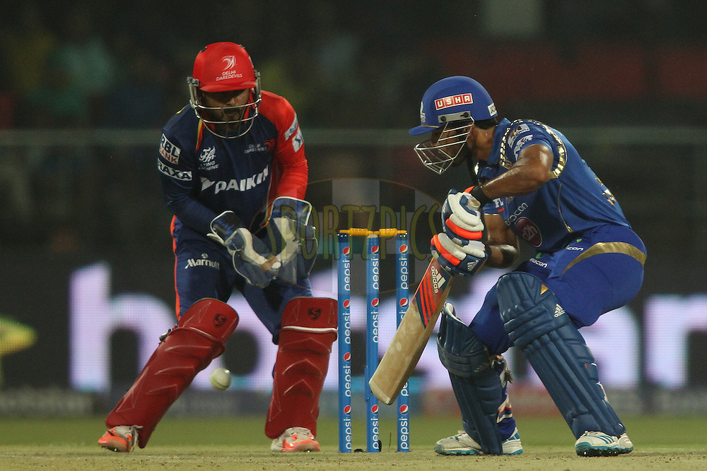 Unmukt Chand of Mumbai Indians plays a late cut during match 21 of the Pepsi IPL 2015 (Indian Premier League) between The Delhi Daredevils and The Mumbai Indians held at the Ferozeshah Kotla stadium in Delhi, India on the 23rd April 2015.<br /> <br /> Photo by:  Shaun Roy / SPORTZPICS / IPL