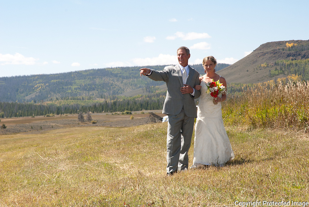 This wonderful wedding took place between Granby, CO and Grand Lake, CO at the brides families ranch.  The wedding ceremony was in a newly cut hayfield with views of the Continental Divide and Lake Granby.  Georgeous and breathtaking!  Photos of the bride and groom were taken around the ranch.  The reception took place at Winding River Resort.  Guests ate to a wonderful pig roast and danced in the old barn.  It was a beautiful day in the fall in Grand County.