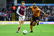 Wolverhampton Wanderers defender (on loan from Porto ) Willy Boly (15) and Aston Villa midfielder Jack Grealish (10) chase the ball during the EFL Sky Bet Championship match between Aston Villa and Wolverhampton Wanderers at Villa Park, Birmingham, England on 10 March 2018. Picture by Dennis Goodwin.