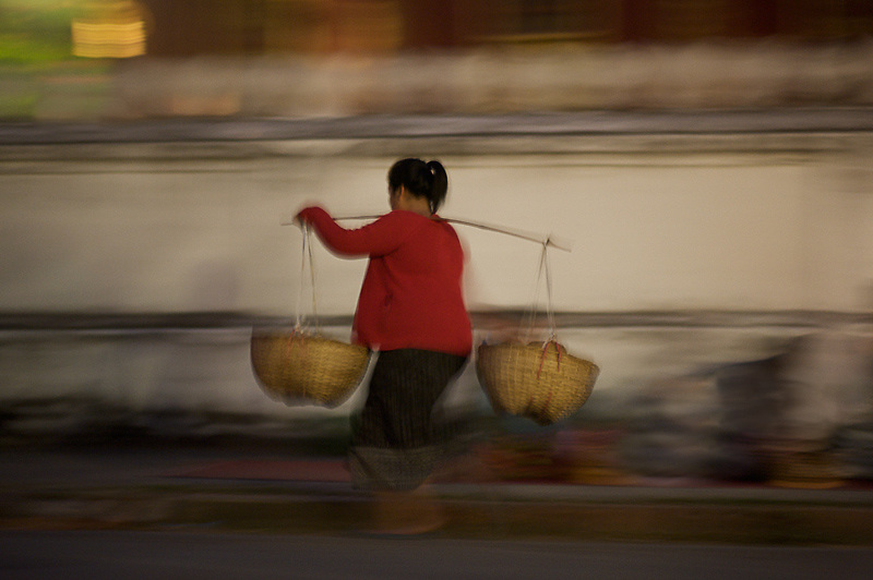 A Market Woman, running towards a customer in the early hours