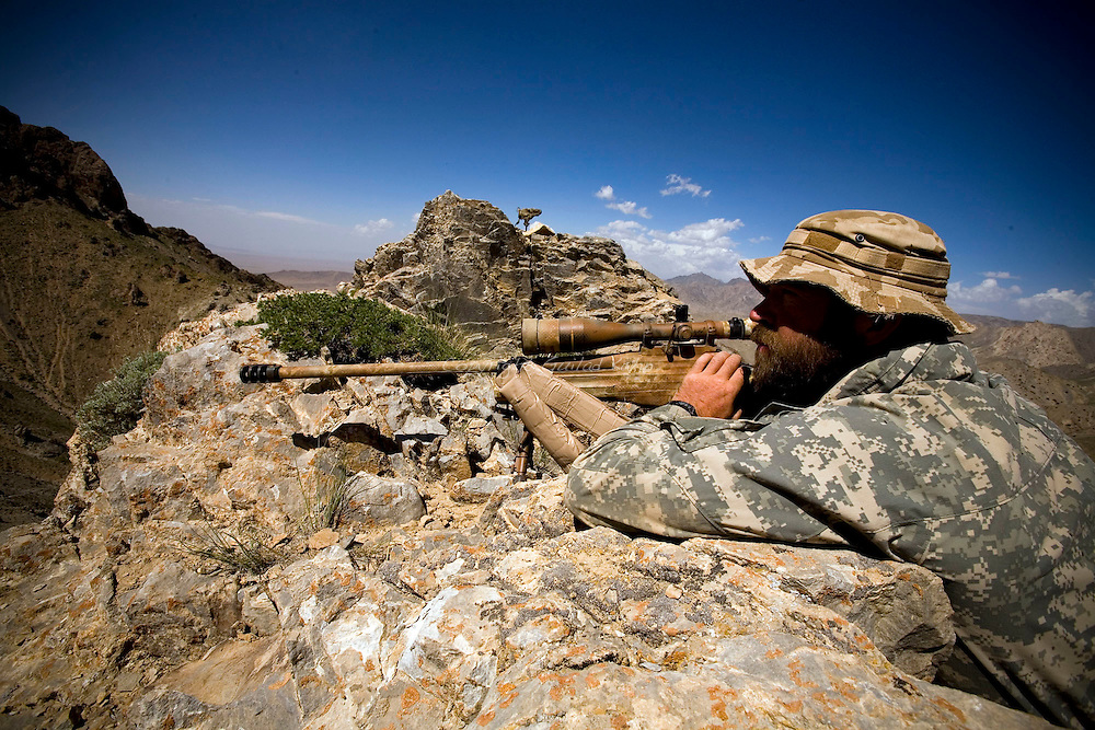 A Czech sniper embedded with US soldiers from Titan task force on top of a mountain overlooking Kherwar valley in their first push into Kherwar district in Afghanistan on May 20-24th 2009..Kherwar Valley in Logar Province is a Taleban controlled region Beleived to house one of Afghanistan's main Taleban HQ's and hundreds of fighters...Photo: Guilad Kahn.
