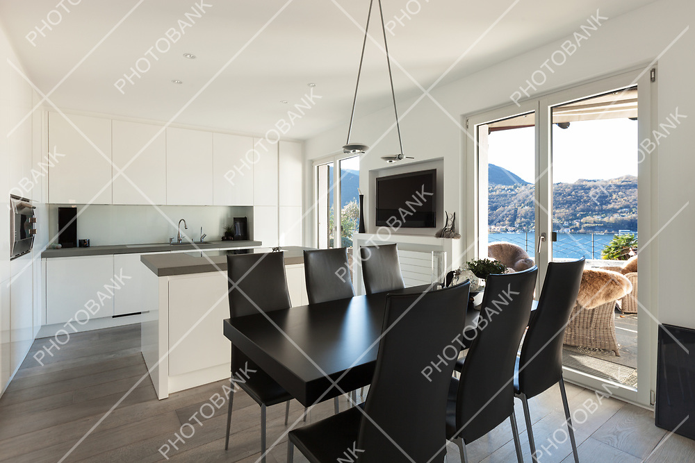 Interior of house, modern kitchen with black dining table