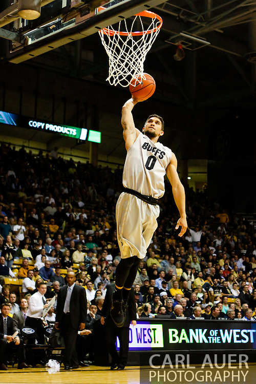 November 13th, 2013:  Colorado Buffaloes junior guard Askia Booker (0) heads to the rim to attempt a dunk in the second half of the NCAA Basketball game between the University of Wyoming Cowboys and the University of Colorado Buffaloes at the Coors Events Center in Boulder, Colorado