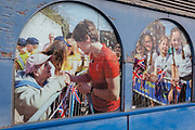 Summer scenes in the peeling window of the 'Age Concern' charity, showing an event in the London suburb of Swanley in which Winter Olympic Skeleton medallist Lizzie Yarnold paraded her medal around Kent towns in 2018, on 3rd February 2020, in London, England