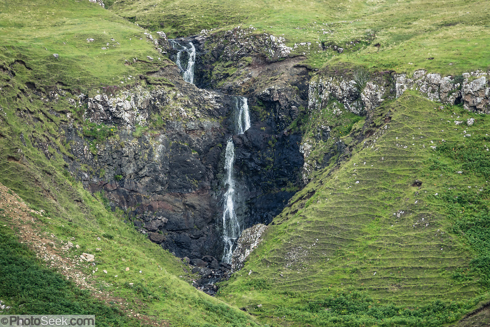 Waterfall in the Fairy Glen (or Faerie Glen), an unusual landscape of grassy, cone-shaped hills near Uig village, on the Trotternish peninsula, in Scotland, United Kingdom, Europe. Walk an easy loop of 1.2 miles round trip (see www.walkhighlands.co.uk).