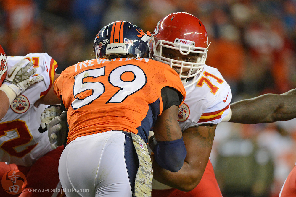 November 17, 2013; Denver, CO, USA; Kansas City Chiefs guard Jeff Allen (71) blocks Denver Broncos outside linebacker Danny Trevathan (59) during the second quarter at Sports Authority Field at Mile High. The Broncos defeated the Chiefs 27-17.