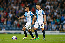 Lee Naylor in action as Jamie Ward of Derby looks on - Photo mandatory by-line: Rogan Thomson/JMP - 07966 386802 - 17/09/2014 - SPORT - FOOTBALL - Blackburn, England - Ewood Park Stadium - Blackburn Rovers v Derby County - Sky Bet Championship.