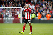 Ollie Norwood of Sheffield United applauds fans after the Premier League match between Sheffield United and Crystal Palace at Bramall Lane, Sheffield, England on 18 August 2019.