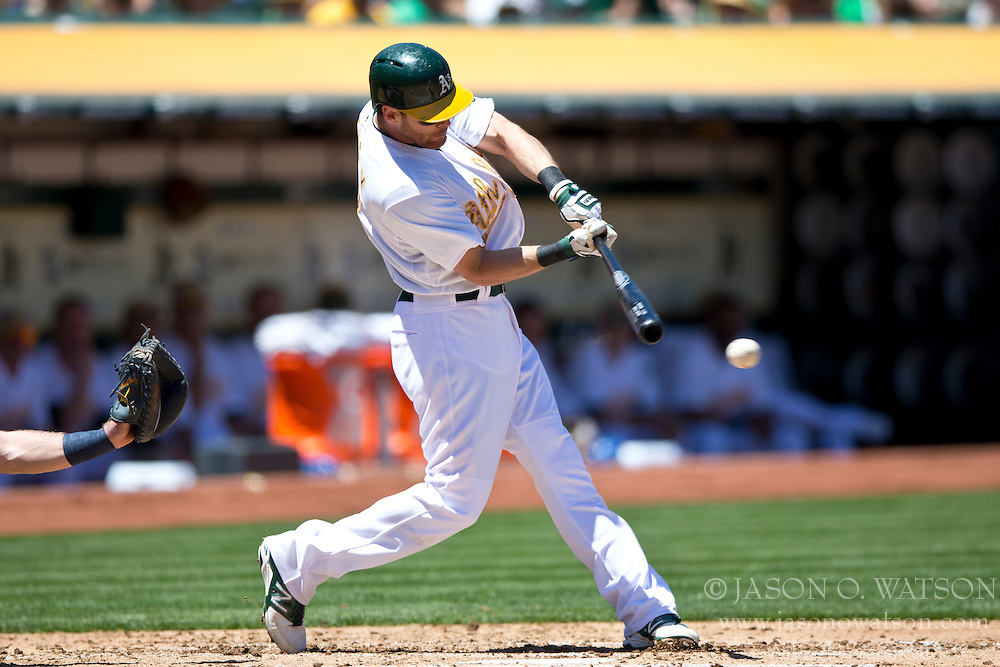 OAKLAND, CA - MAY 26:  Craig Gentry #3 of the Oakland Athletics at bat against the Detroit Tigers during the second inning at O.co Coliseum on May 26, 2014 in Oakland, California. The Oakland Athletics defeated the Detroit Tigers 10-0.  (Photo by Jason O. Watson/Getty Images) *** Local Caption *** Craig Gentry