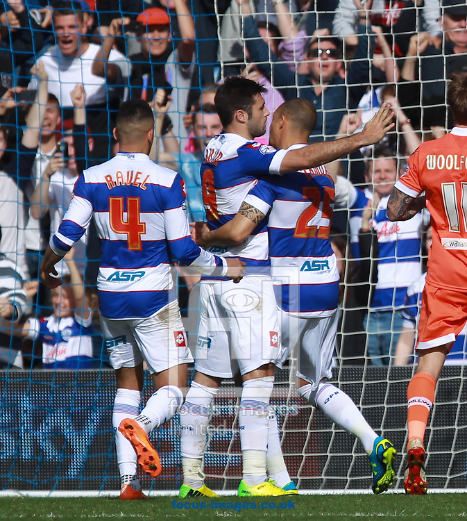 Charlie Austin of Queens Park Rangers celebrates opening the scoring from the spot against Millwall during the Sky Bet Championship match at the Loftus Road Stadium, London<br /> Picture by John Rainford/Focus Images Ltd +44 7506 538356<br /> 26/04/2014