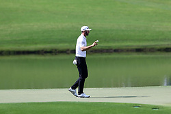 September 23, 2017 - Atlanta, Georgia, United States - Dustin Johnson waves to the crowd after putting the 8th green during the third round of the TOUR Championship at the East Lake Club. (Credit Image: © Debby Wong via ZUMA Wire)