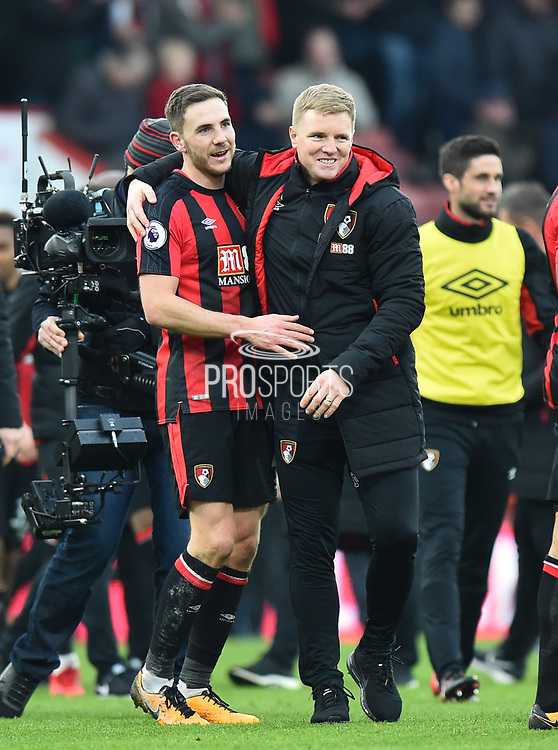 AFC Bournemouth manager Eddie Howe celebrates the 2-1 win over Arsenal at full time with Dan Gosling (4) of AFC Bournemouth during the Premier League match between Bournemouth and Arsenal at the Vitality Stadium, Bournemouth, England on 14 January 2018. Photo by Graham Hunt.