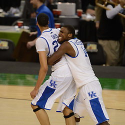 Mar 31, 2012; New Orleans, LA, USA; Kentucky Wildcats forward Michael Kidd-Gilchrist (14) hugs forward Anthony Davis (23) after defeating the Louisville Cardinals 69-61 in the semifinals of the 2012 NCAA men's basketball Final Four at the Mercedes-Benz Superdome. Mandatory Credit: Derick E. Hingle-US PRESSWIRE