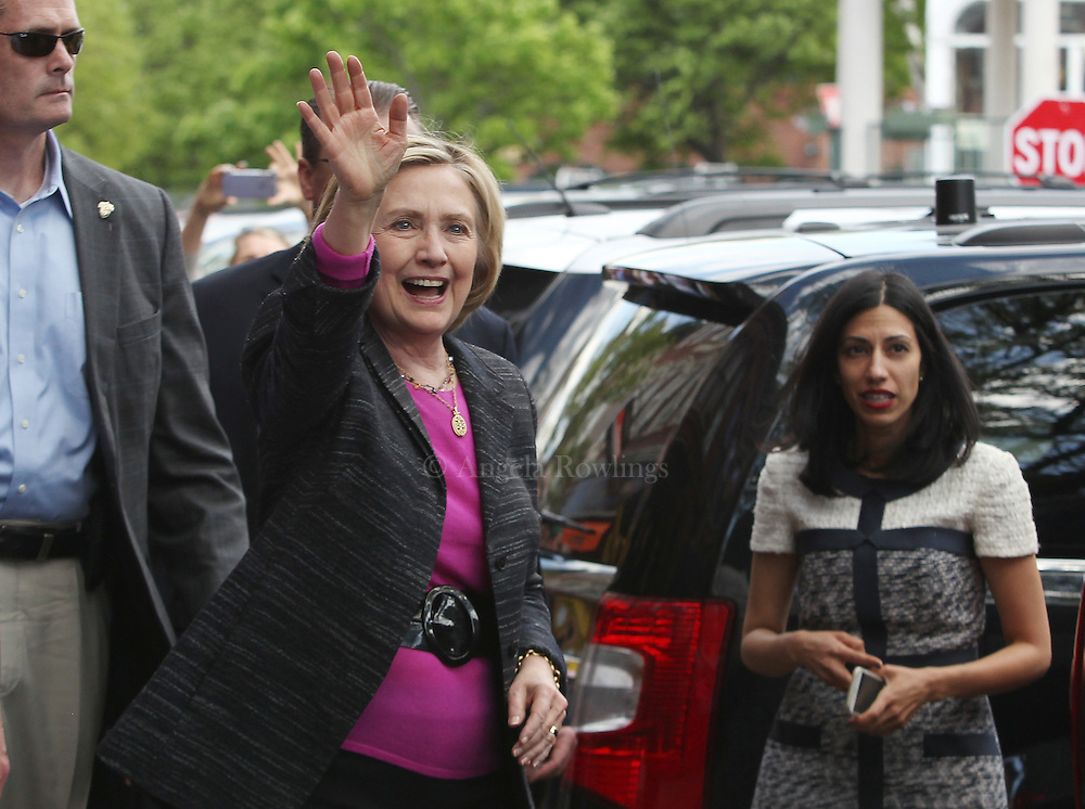 (Exeter, NH - 5/22/15) Former Secretary of State and presidential candidate Hillary Clinton waves to a crowd gathered on Water Street in Exeter as she departs from a campaign stop, Friday, May 22, 2015. Huma Abedin is at right. Staff photo by Angela Rowlings.