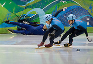 Apolo Anton Ohno and J.R. Celski skate past two falling South Korean skaters en route to placing second and third in the Men's 1500m short track speed skating event at the 2010 Olympic Winter Games Saturday in Vancouver.