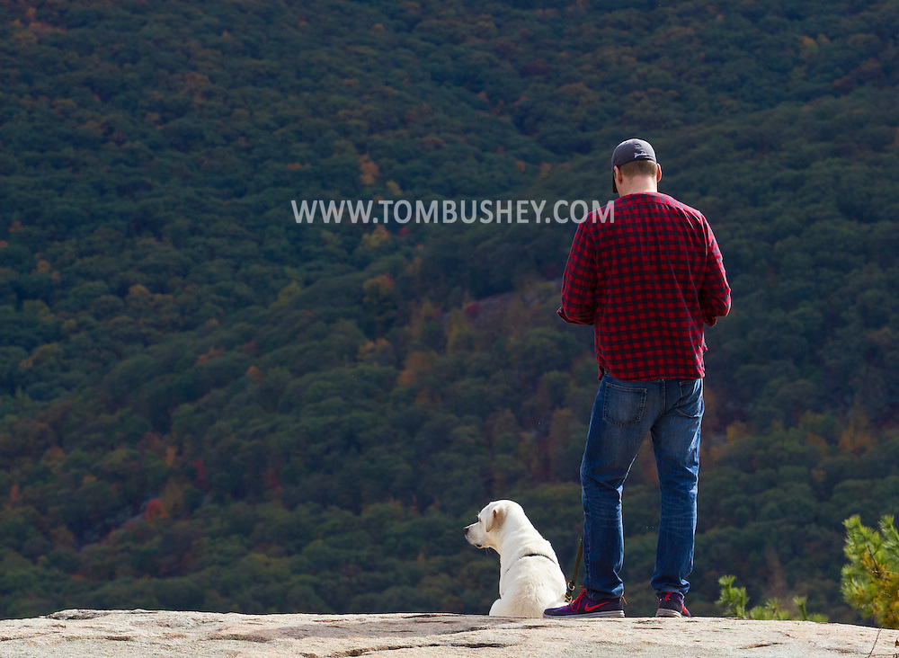 Bear Mountain, New York - A man and his dog on a rocky area at the top of Bear Mountain on Oct. 2, 2014.