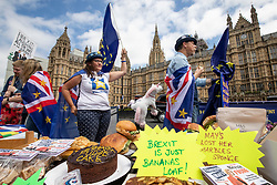 © Licensed to London News Pictures. 20/06/2018. London, UK. Anti-Brexit protesters offer themed cakes and wave European Union flags opposite Parliament as MPs prepare to debate the EU Withdrawal Bill. Photo credit: Rob Pinney/LNP