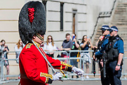An overwight Guards officer leads his Company - His Royal Highness the Duke of York reviews the final rehearsal for the Trooping the Colour on Horseguards Parade and the Mall.