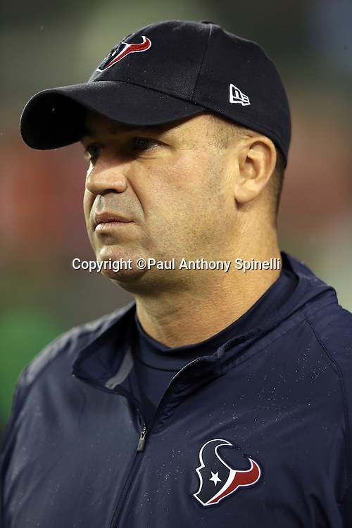 Houston Texans head coach Bill O'Brien looks on as the team warms up before the 2015 week 10 regular season NFL football game against the Cincinnati Bengals on Monday, Nov. 16, 2015 in Cincinnati. The Texans won the game 10-6. (©Paul Anthony Spinelli)