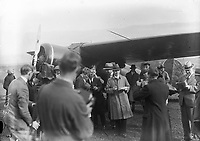Miss Amelia Earhart, Atlantic Flier at Derry. Beside aircraft. <br /> On 20th May 1932 Amelia Earhart flew her Lockheed Vega from Harbour Grace, Newfoundland, to Derry, Northern Ireland. This flight broke several records. As well as being the first woman to fly the Atlantic solo it was also the longest non-stop distance flown by a by a woman. <br /> On Saturday, 21 May 1932, Amelia Earhart was on her second Atlantic crossing when she was forced to land in a field near Derry in her &quot;Little Red Bus&quot;.<br /> The hospitality she had received after making her forced descent, for two minutes later she was in the cottage of Mr and Mrs Peter McCallion, who put their home at her disposal. Almost at the same time Mr Gallagher arrived and persuaded Miss Earhart to accompany him to his home, where Mrs Gallagher had tea already prepared.&quot; There was no account of how the McCallions took to having the Gallaghers scoop them in what must have been the tea party of their lives!<br /> (Part of the Independent Newspapers Ireland/NLI Collection)