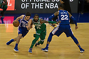 Philadelphia 76ers T.J McConnell (12) and Boston Celtics Kyrie Irving (11)  during the NBA London Game match between Philadelphia 76ers and Boston Celtics at the O2 Arena, London, United Kingdom on 11 January 2018. Photo by Martin Cole.