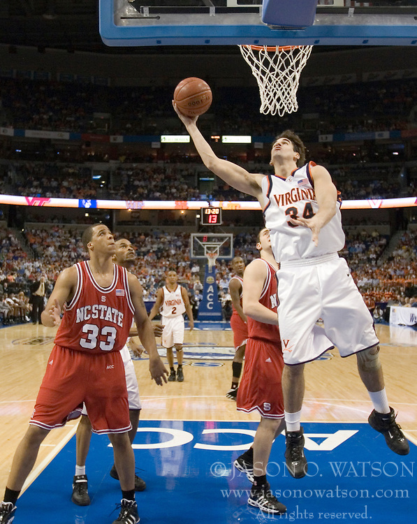Virginia Cavaliers forward/center Ryan Pettinella (34) shoots against NC State.  The Virginia Cavaliers Men's Basketball Team fell to the North Carolina State Wolfpack 76-71 in the quarterfinal round of the 54th ACC Tournament at the St. Pete's Times Forum in Tampa, FL on March 9, 2007.